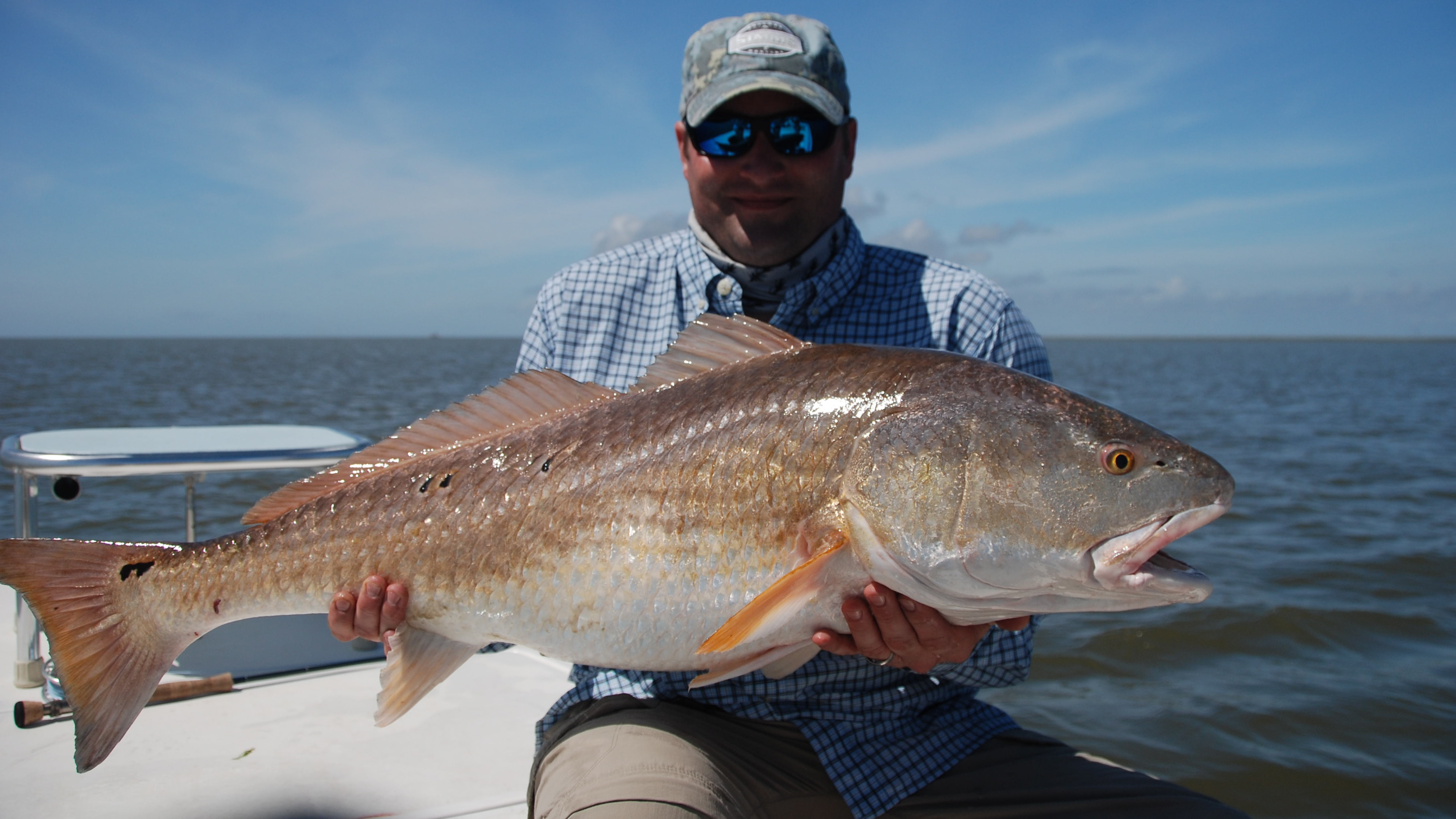 More late season big redfish shallow south for Fly fishing redfish