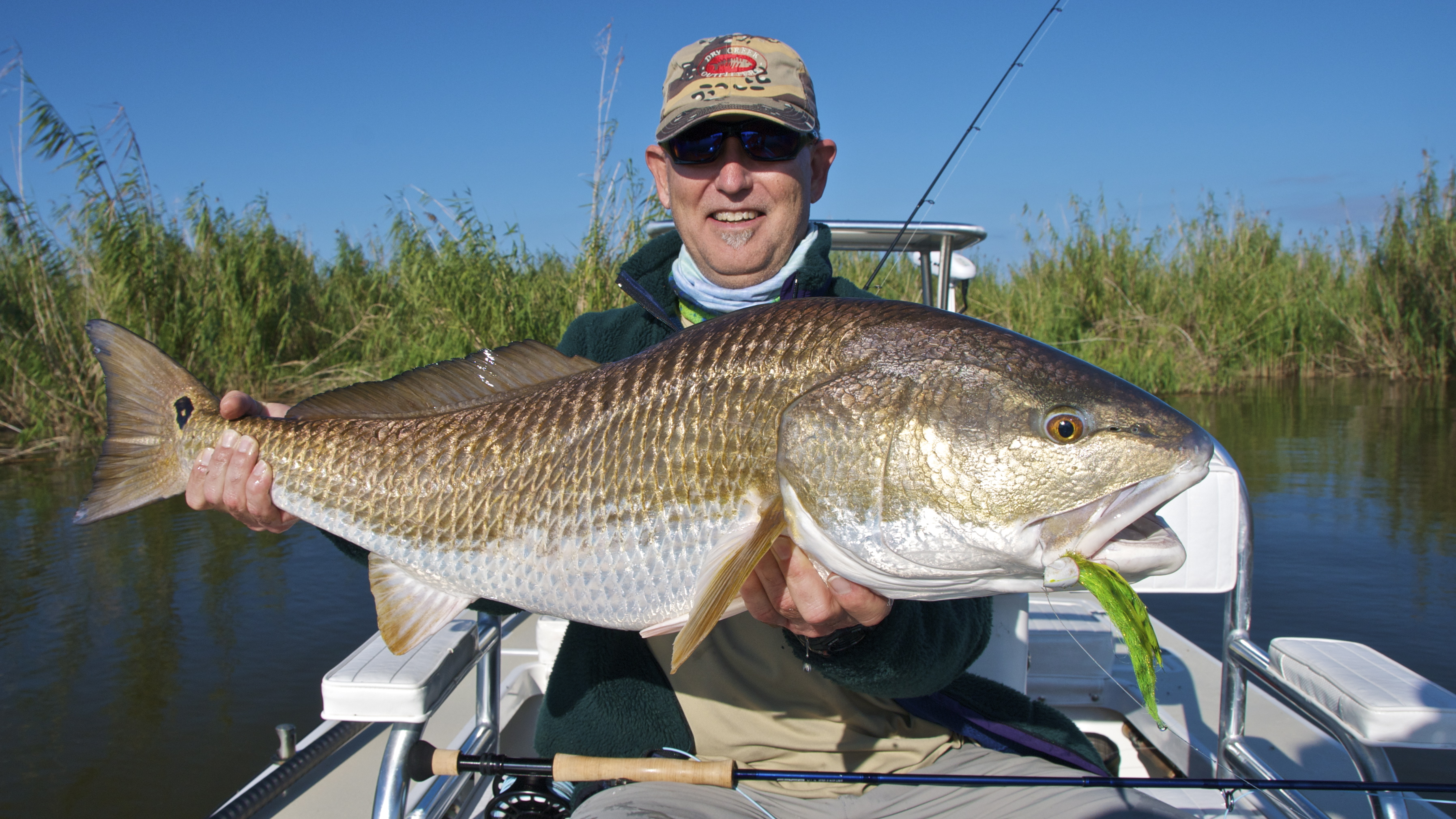 Going for fly fishing records shallow south for Fly fishing for redfish